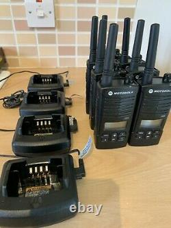 7 X Motorola XTNiD Radios with 4 X chargers. Complete Excellent Condition